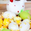 Yellow and green easter eggs with a ceramic hen — Stock Photo #40773279