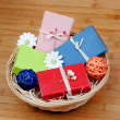 Stock Photo: Handmade soaps on basket decorated with flowers