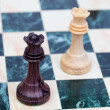 Stock Photo: Two faced queens Wooden chess pieces