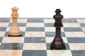The king and queen faced. Wooden chess pieces — Stock Photo