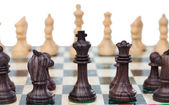 Chess pieces on chessboard — Stock Photo