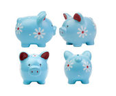 Four piggy banks  each in different position  — Stock Photo