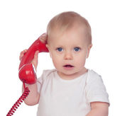 Beautiful baby with a red phone — Stock Photo