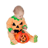 Blond baby in pumpkin suit — Stock Photo
