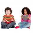 Two children sitting on the floor reading — Stock Photo #46653571