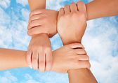Joined hands in a symbol of cooperation   — Stock Photo