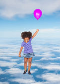 African little girl flying on the sky — Stock Photo