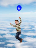 Child flying with a balloon — Stock Photo