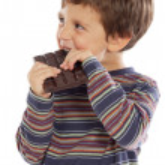 Child eating chocolate — Stock Photo #9431992