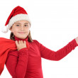 Beautiful girl with hat of christmas indicating — Stock Photo #9497356