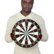 Attractive african man with target — Stock Photo #9500958