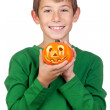 Adorable child with a pumpkin — Stock Photo #9501712