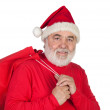 Funny Santa Claus with red sack — Stock Photo #9504092