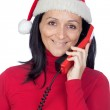 Beautiful girl with Christmas hat to phone — Stock Photo #9507460