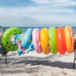Ring Buoys on Beach — Stock Photo #27748619