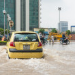 Taxi Struggling Through Flood — Stock Photo