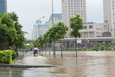 Motorbike Riding on Flooded Pavement — Stock Photo