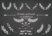 Chalkboard set with laurels, wreaths, arrows and hearts — Stock Vector