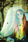 Young beautiful woman on motorcycle — Stock Photo