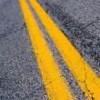 Stock Photo: Yellow dividing lines on highway