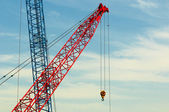Two construction cranes over blue sky — Stock Photo