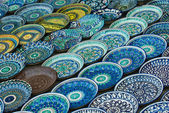 Background of traditional Uzbek ceramic plates — Stock Photo
