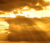 Stormy cloud with sun rays — Stock Photo