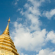 Golden stupa over blue sky background with copyspace — Stock Photo