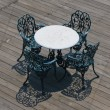 Stock Photo: Metal chairs and round table