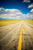 Vibrant image of highway and blue sky — Stock Photo