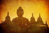 Vintage image of Buddha statue at Borobudur temple, Java, Indone — Stock Photo