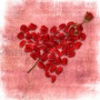 Grunge background with heart made od rose petals — Foto de Stock