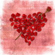 Stock Photo: Grunge background with heart made od rose petals