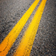 Yellow dividing lines on the highway — Stock Photo #17688831