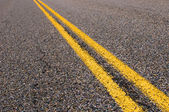 Yellow dividing lines on the highway — Stock Photo