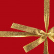 Golden gift ribbon — Stock Photo