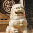 Guardian lion in songzanlin tibetan monastery, shangri-la, china - Stock Photo