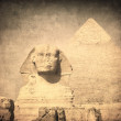 Grunge image of sphynx and pyramid — Stock Photo