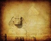 Imagen grunge de sphynx y pirámide — Foto de Stock