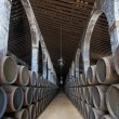 Stock Photo: Sherry barrels in Jerez bodega, Spain