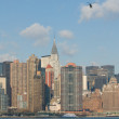 Panorama of manhattan with flying helicopter - Stock Photo