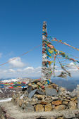 Tibetan prayer flags over snow mountains — Foto de Stock