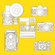 Vintage photo cameras set  with floral pattern. — Stock Vector