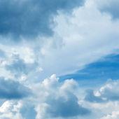 Blue cloudy sky vector background — Stock Vector