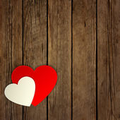 Paper heart on the wooden background — Vettoriale Stock
