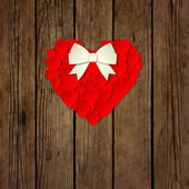 Heart with a bow on a wooden background vector — Vecteur