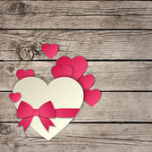 Heart with a bow on a wooden background vector — ストックベクタ