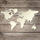 Paper world map on a wooden board vector — Cтоковый вектор
