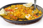 Delicious seafood paella in the pan — Stock Photo