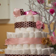 Stock Photo: Cakes made of diapers on white